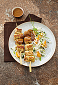 Turkey skewers with a peanut sauce