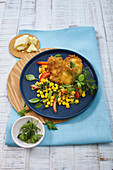 Curry chicken piccata with a sweetcorn and tomato salad