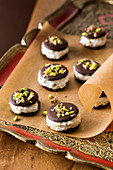 Chocolate confectionery with ricotta cream, candied fruits and pistachios