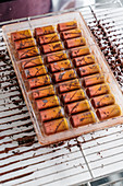 Mango and passion fruit pralines with pink pepper