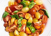 Colourful tomato salad with basil