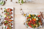 Spieced honey roasted sweet potatoes with tahini dressing, chargrilled vegetable salad with whipped basil feta