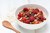 Porridge with red berries and pomegranate seeds