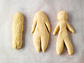 Traditional Weckmänner (person-shaped buns) being made