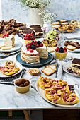 Various low carb cakes and baked goods on a buffet