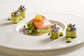 Gently cooked salmon trout fillet on a potpourri of cucumber