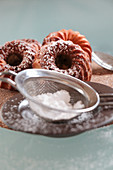 Mini marble Bundt cakes dusted with icing sugar
