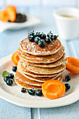 Poppyseed pancakes with apricots and berries