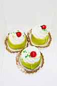 Sweet cakes on white background