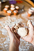 Childs hands holding dough