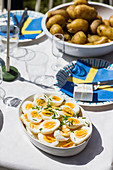 A Swedish buffet with hard-boiled eggs and potatoes