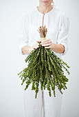 A woman holding a bunch of myrtle