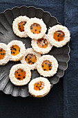 Coconut biscuits with passion fruit jelly