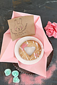 Handmade Easter card and biscuit with heart-shaped cut-out