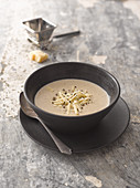 Mushroom soup with Parmagsian cheese and black pepper
