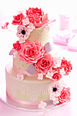 A wedding cake with roses and sugar flowers