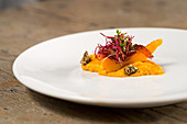 Hokkaido pumpkin with beetroot sprouts and pumpkin crackers