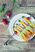 Raw organic zucchini blossom flowers on skewer