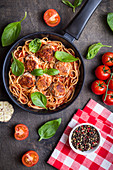 Spaghetti with meatballs, tomato sauce and ingredients