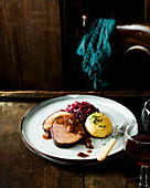Sauerbraten with raisins, red cabbage and mashed potatoes