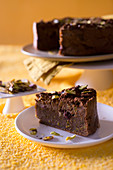 Dark chocolate cake made with cornmeal, cranberries and pistachios