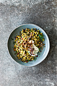 Vegan mujadarra made from green lentils, rice and barberries