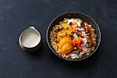 Oriental bulgur and orange bowl