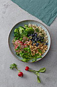 Superfood bowl with blueberries and water cress