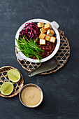 Vegan Thai Buddha bowl with red rice and tofu