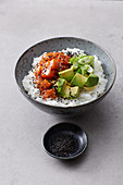 Poke bowl with raw salmon