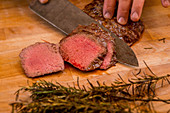 Sliced beef tenderloin with rosemary (medium rare)