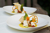 Yellow tomato and pepper cream with goat's cheese mousse