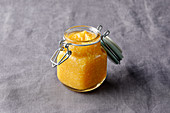 Persimmon spread with oranges, coconut and ginger