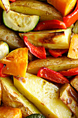 Oven-roasted potatoes with pumpkin, peppers and courgettes (full-frame)
