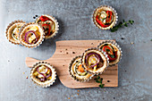 Tartlets with various vegetable fillings and mozzarella