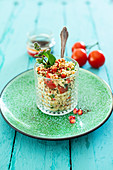 Couscous salad with pomegranate, mint, sumac and tomatoes