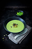 Vegan edamame cream soup with green rice flakes (low carb)