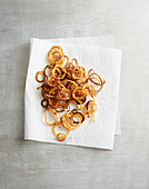 Fried onions on kitchen paper