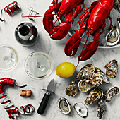 Lobsters on ice, fresh oysters, and sparkling wine for a party