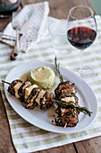 Pork fillet and herb kebabs with zucchini flan