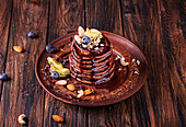Vegan avocado pancakes with cocoa and date syrup