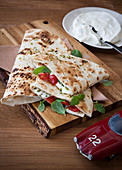 Homemade piadina with cream cheese, pistachios and cherry tomatoes