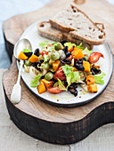 Sweet and sour olive and pumpkin vegetables with dates and celery