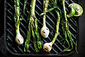 Cebollitas (grilled green onion bulbs) on csat iron griddle with squeezed lime