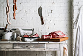 Vintage butcher counter against white brick wall