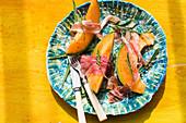 Melon with parma ham and wild rocket