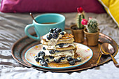Gluten free banana pancakes with blueberries and soy yoghurt