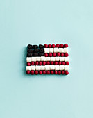 An American flag made from berries and marshmallows