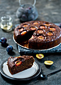Chocolate zucchini cake with plums