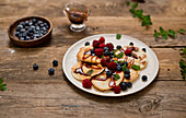 Pancakes with date syrup and berries